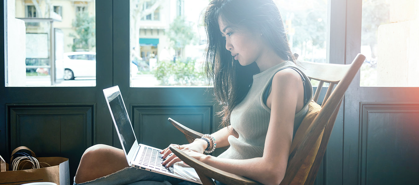 Woman in a coffee shop on a computer